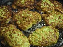 Delicious Zucchini fritters with olive oil. Stock Photo