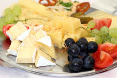 Deliciouse plate. Cheese and fruit plate Royalty Free Stock Photo