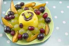 Deliciously decorated fruit salad with pudding Royalty Free Stock Images