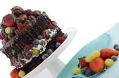Deliciously divine chocolate cake with berries and cream. Stock Photos