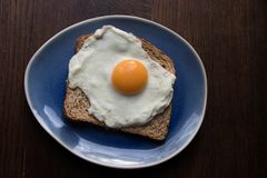 Good morning, what a wonderful start of the day. A deliciously fried egg at breakfast, is a wonderful start of the day, made with love bij mom royalty free stock images