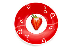 Deliciously half a red strawberry romantic plate Stock Photos