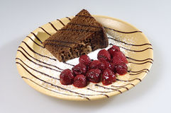 Deliciously looking dessert. Plate with chocolate cake and raspberry dessert Royalty Free Stock Photos