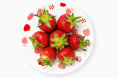 Deliciously red strawberries romantic plate Stock Photography