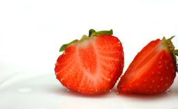 Deliciously red strawberry cut into half Royalty Free Stock Images