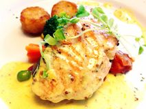 Deliciously seared salmon in cream sauce. Gourmet salmon dish Royalty Free Stock Images