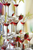 Deliciuos red coctail tower with strawberries Royalty Free Stock Images