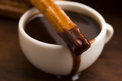 Deliciuos spanish Churros with chocolate Royalty Free Stock Photography