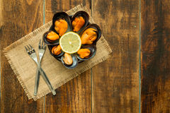 Delicius appetizer with natural mussels. And lemon Stock Photo