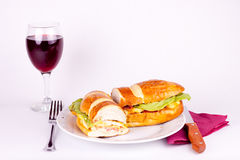 Delicius breakfast with glass of wine. Delicius sandwich with set for dining and a glass of wine Stock Images