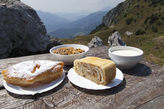 Delicius food on a wooden table high in the mountains Stock Photography