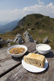 Delicius food on a wooden table high in the mountains. Delicius home made organic food on a wooden table high in the mountains, selective focus on food Stock Images