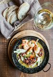 Fried seafood, shrimp, octopus, squid on the plate royalty free stock image