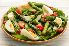 Delicius salad with green asparagus, tomatoes and eggs.  Stock Photo