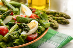 Delicius salad with green asparagus, tomatoes and eggs. Royalty Free Stock Photography