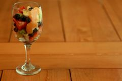Delicious fruit salad on a kitchen table Royalty Free Stock Images