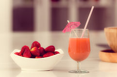 Delicous strawberry juice in a glass and fresh Stock Photography