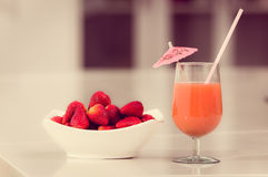 Delicous strawberry juice in a glass and fresh Stock Image