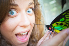 Delight of girl. Holding a butterfly on a hand stock image