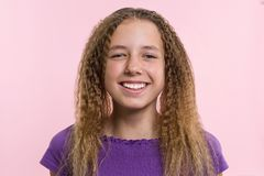 Delight, happiness, joy, victory, success and luck. Teen girl on a pink background. Facial expressions and people emotions concept.  royalty free stock photography