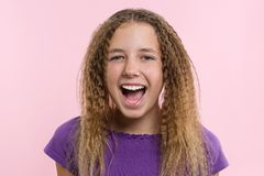 Delight, happiness, joy, victory, success and luck. Teen girl on a pink background. Facial expressions and people emotions concept.  Stock Image
