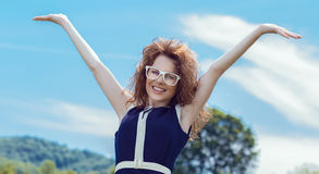 Delight woman with outstreched arms. Stock Image