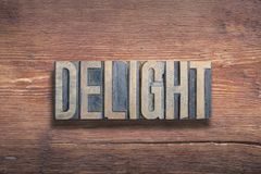 Delight word wood. Delight word combined on vintage varnished wooden surface royalty free stock images