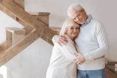 Delighted aged couple hugging each other Royalty Free Stock Photography