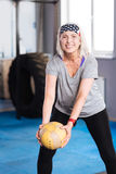 Delighted aged woman exercising with a ball Royalty Free Stock Photos