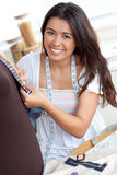 Delighted asian woman sewing Stock Photography