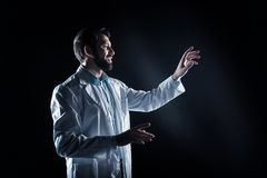 Delighted bearded man wearing a labcoat Royalty Free Stock Photos