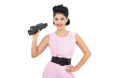 Delighted black hair model holding binoculars Royalty Free Stock Image