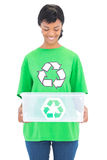 Delighted black haired ecologist holding a recycling box Royalty Free Stock Photo
