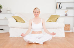 Delighted blonde woman practicing yoga Stock Photo