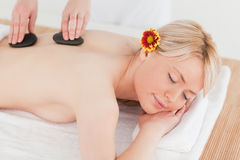 Delighted blonde woman receiving a massage Stock Images