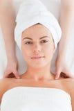 Delighted brunette enjoying a shoulder massage Royalty Free Stock Photo