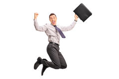 Delighted businessman jumping out of joy. Delighted businessman holding a suitcase and jumping out of joy isolated on white background stock photos