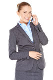 Delighted businesswoman chatting on her mobile Royalty Free Stock Photo