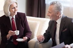 Delighted businesswoman having the conversation with her colleague Royalty Free Stock Images