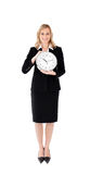 Delighted businesswoman holding a clock Royalty Free Stock Photography