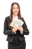 Delighted businesswoman holding a stack of money Royalty Free Stock Image