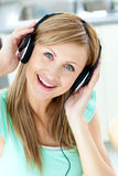 Delighted caucasian woman listening to music Stock Photos