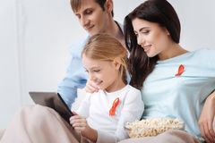Delighted close knit family looking at the tablet screen Stock Image