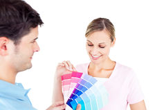 Delighted couple choosing color for a room Stock Photos