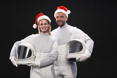 Delighted couple of cosmonauts are expressing amorousness Stock Image