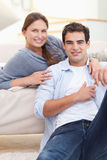 Delighted couple hugging royalty free stock photography