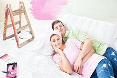 Delighted couple lying on the sofa after painting Royalty Free Stock Image