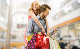 Delighted couple on the shopping Royalty Free Stock Images