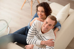 Delighted couple sitting on the couch Royalty Free Stock Photography