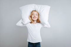 Delighted cute girl holdign pillow Stock Photos
